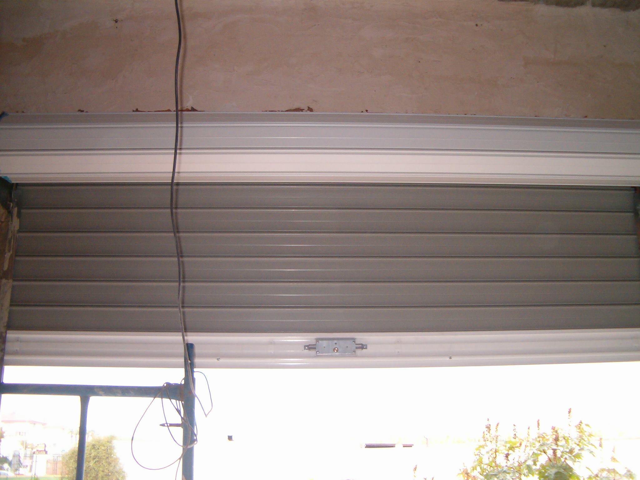 Puertas de cocheras garajes en malaga aluminios guti s c a for Puertas para garajes