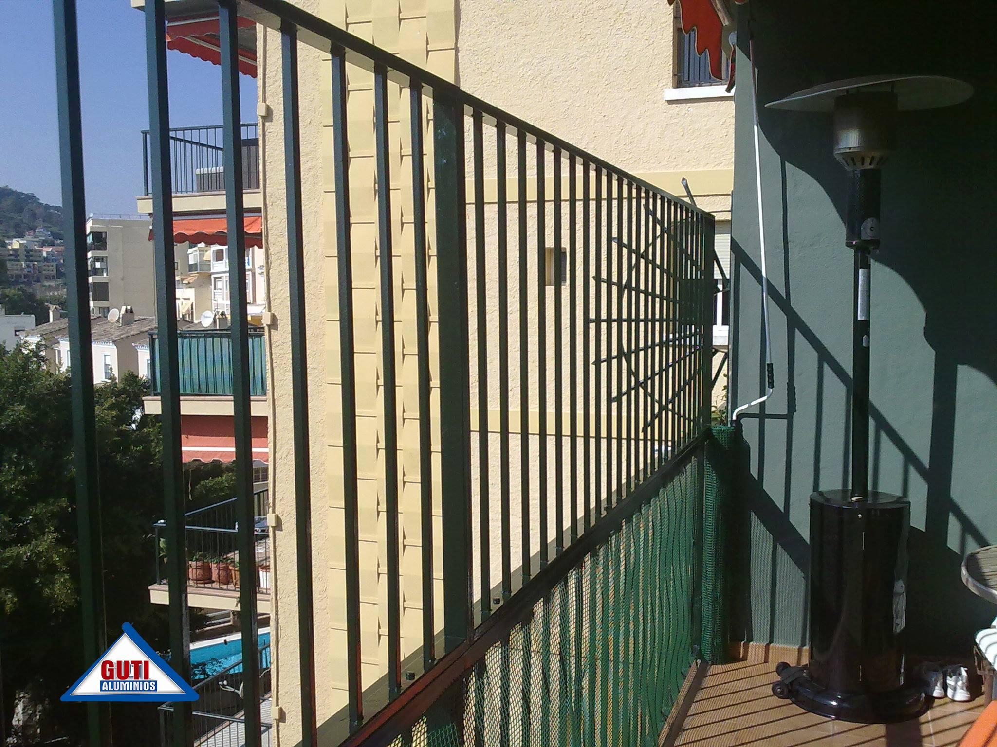 Fabricaci n e instalaci n de baranda de hierro en m laga for Puertas en malaga baratas